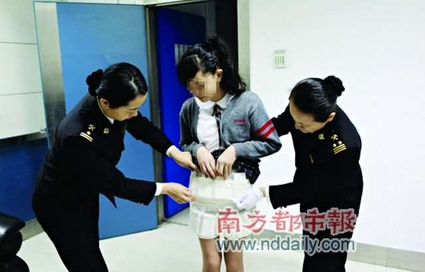 China Police Investigating Housewife For Smuggling iPhone and iPad