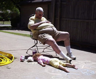 funny picture: Grandpa and little child sleeping on driveway