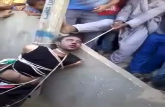 بالفيديو فلاح مصري يقوم بشنق شاب أمام أهل القرية  والجميع يشاهد !  +18
