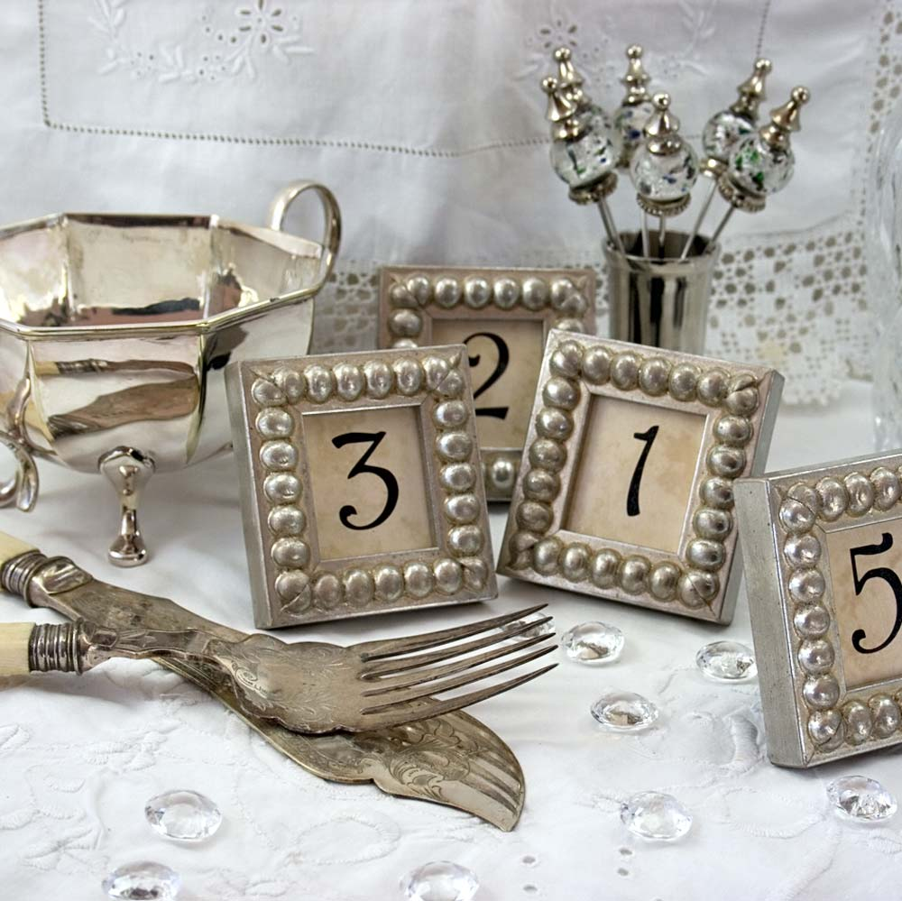 Details in the decor table numbers in silver boules mini frames table numbers in silver boules mini frames for weddings events restaurants banquets jeuxipadfo Image collections