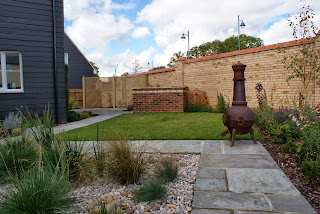 Modern family garden with brick built BBQ