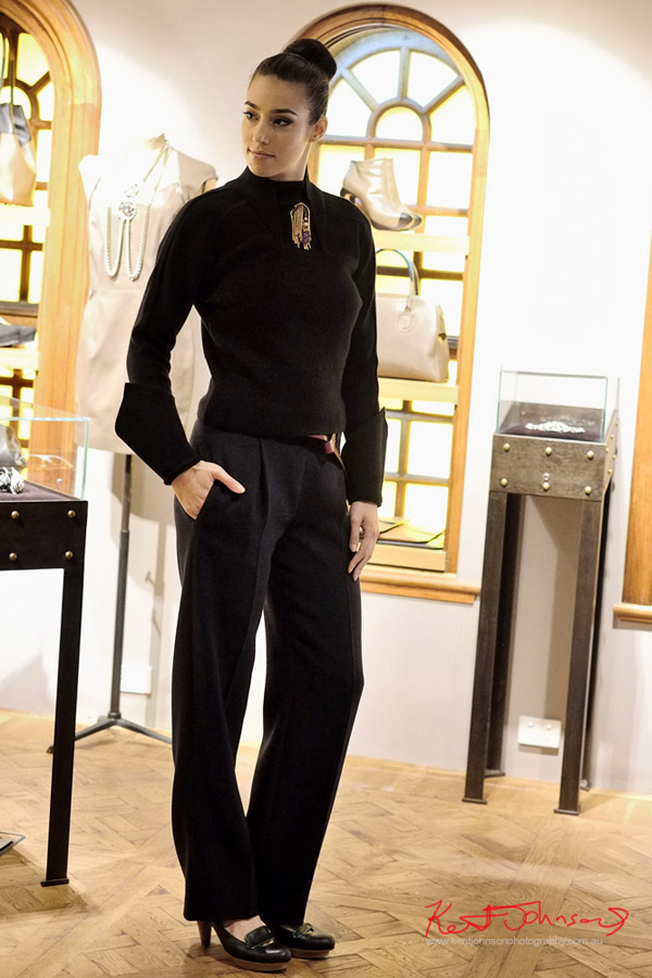 Model wears, Mugler Black jumper, Vintage Pierre Cardin brooch, Veronique Leroy Wide navy pants.