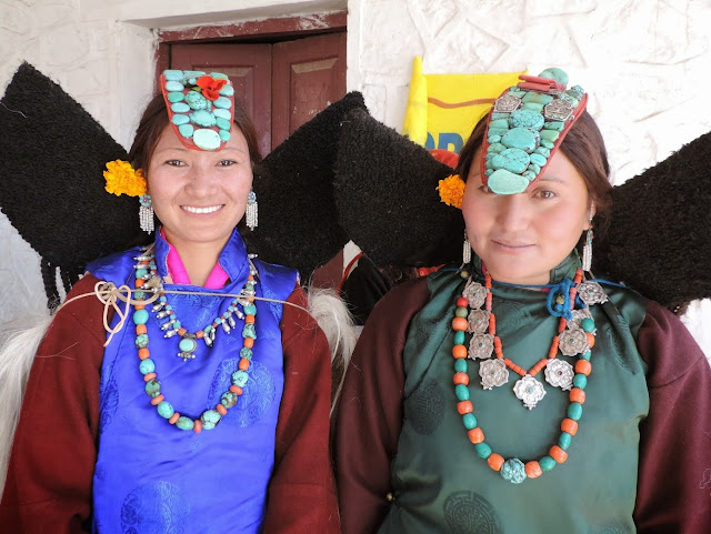 Ladakhi women wearing traditional necklaces,