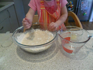 Mixing wet ingredients into dry for muffin recipe