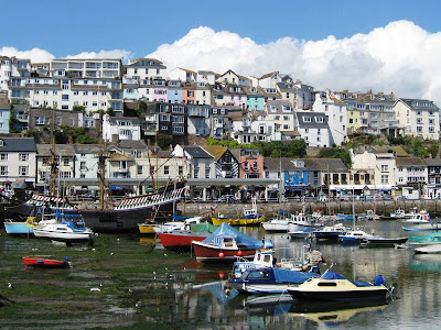 Boats in the harbour and seafront buildings