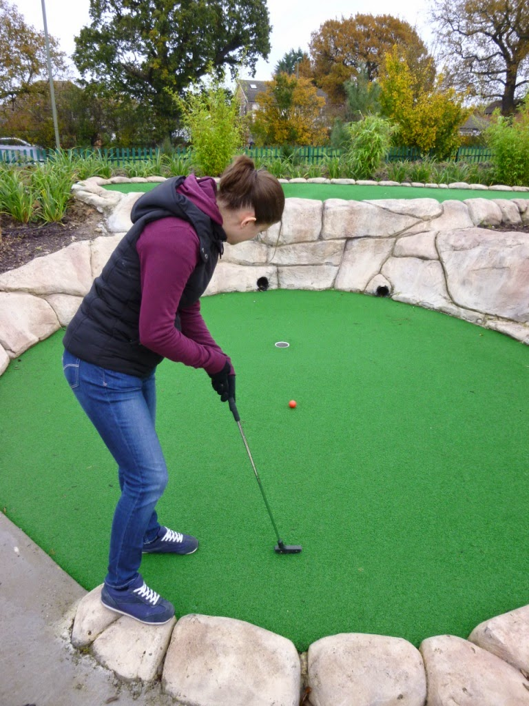Emily Gottfried playing at Jungle Island Adventure Golf course at Horton Park Golf Club in Epsom, Surrey
