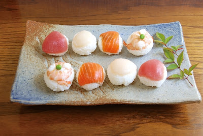 ball shaped sushi made by pressing rice and fish into a ball shaped ...