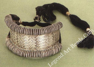 Silver baju-band (arm band) from Rajasthan, worn by the women of the fat and Mina communities. The drawstring makes the ornament adjustable to the size of the wearer.