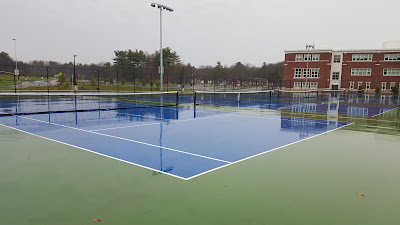 shiny new tennis courts in the rain at Franklin High School