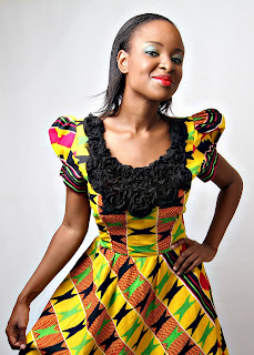 Kente play dress with black trimming