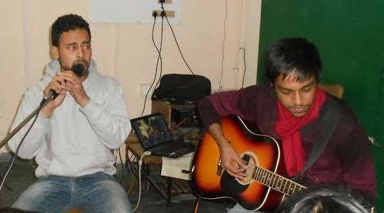 students performing live punjabi songs with guitar