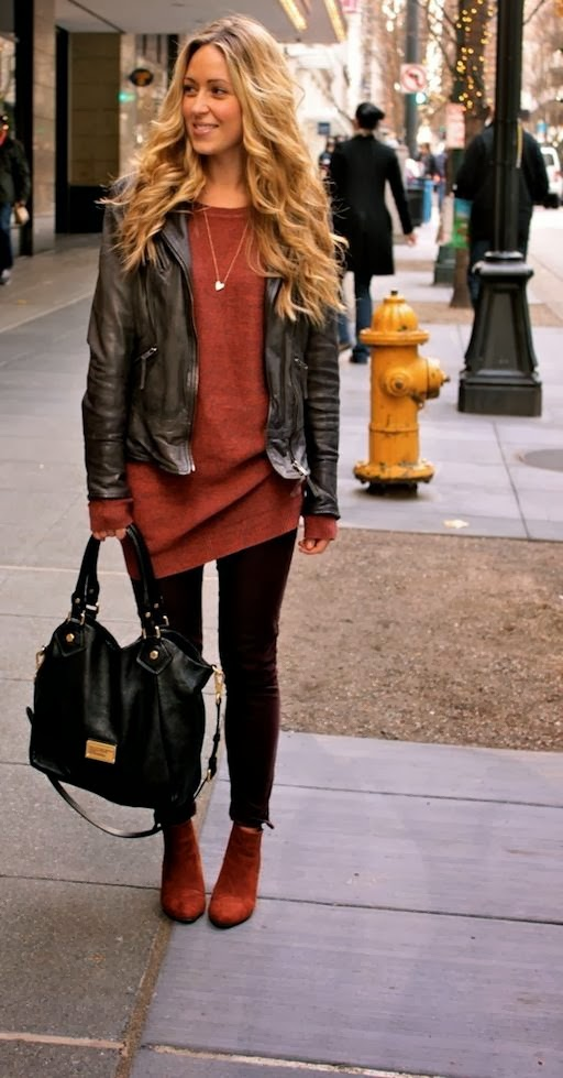 Leather jacket with a tunic sweater.