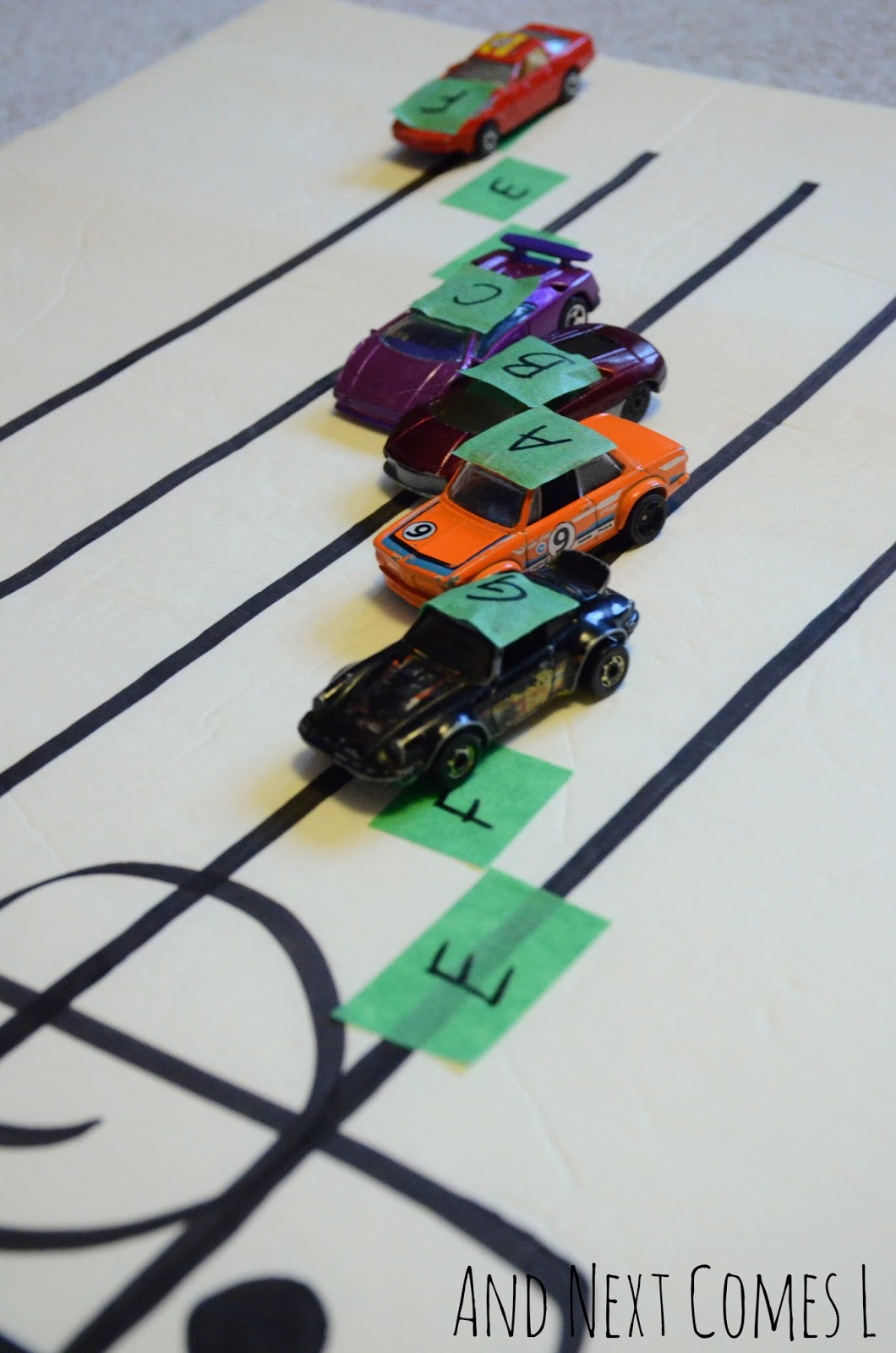 music theory game for kids learning about grand staff using cars from and next comes