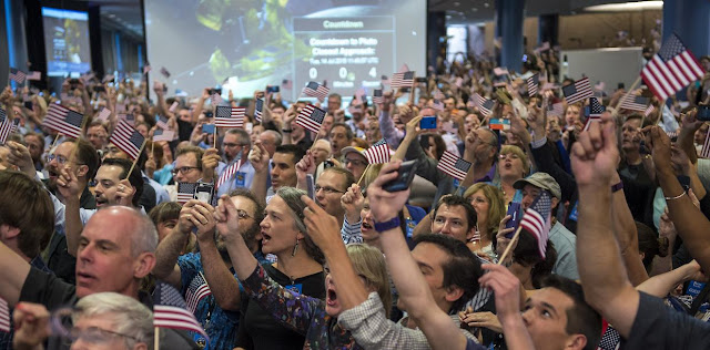 Guests and New Horizons team members countdown to the spacecraft's closest approach to Pluto, Tuesday, July 14, 2015 at the Johns Hopkins University Applied Physics Laboratory (APL) in Laurel, Maryland. Credit: NASA/Bill Ingalls