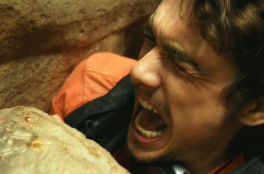 aron ralstons physical and psychological battle in the film 127 hours