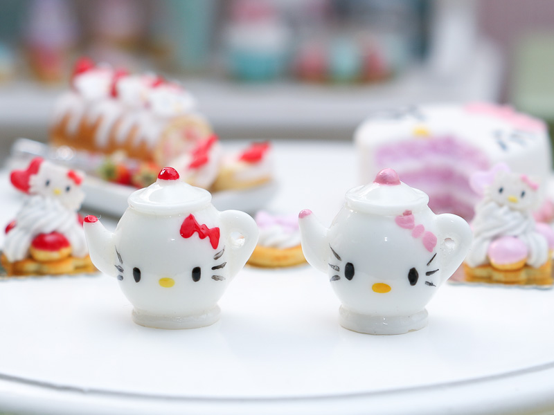Pink and red hand-painted Hello Kitty teapots