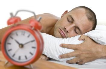 Man_Asleep_With_Clock - How To Ensure Sound Sleep