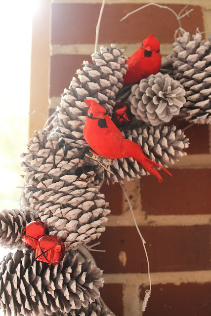 red bird and white pinecone wreath