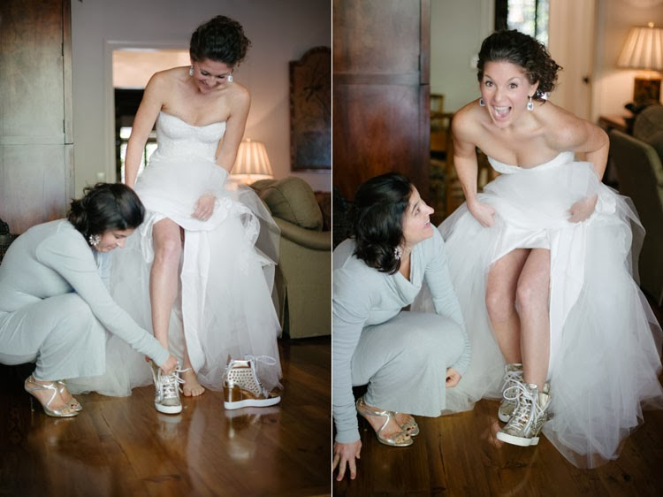 bride slipping on her Giuseppe Zanotti shoes to go with her Monique Lhuillier wedding dress