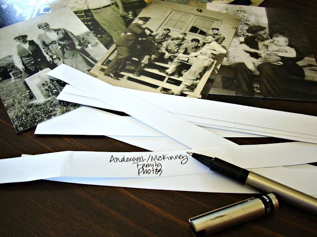 Organize your family photos by wrapping them with white cardstock labels