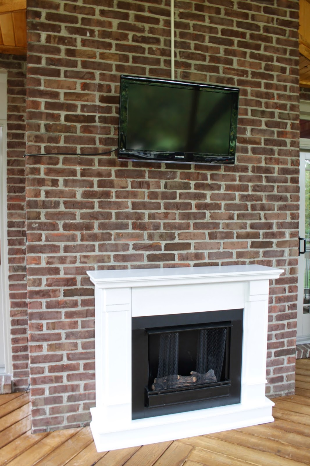 real flame fireplace on screened porch