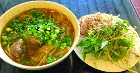 Bun Bo Ganh Restaurant Add: 88 Ho Tung Mau, Ben Nghe Ward, District 1, HCM City Tel: 08 - 66844446 Opening hours: 6:30am-10pm Price range: VND22,000 - 39,000 (US$1-2)