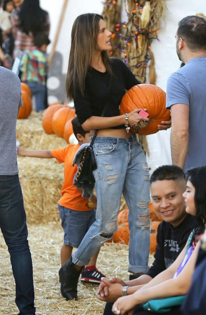 Alessandra Ambrosio in a cropped top and ripped jeans at the Mr. Bones Pumpkin Patch in Hollywood