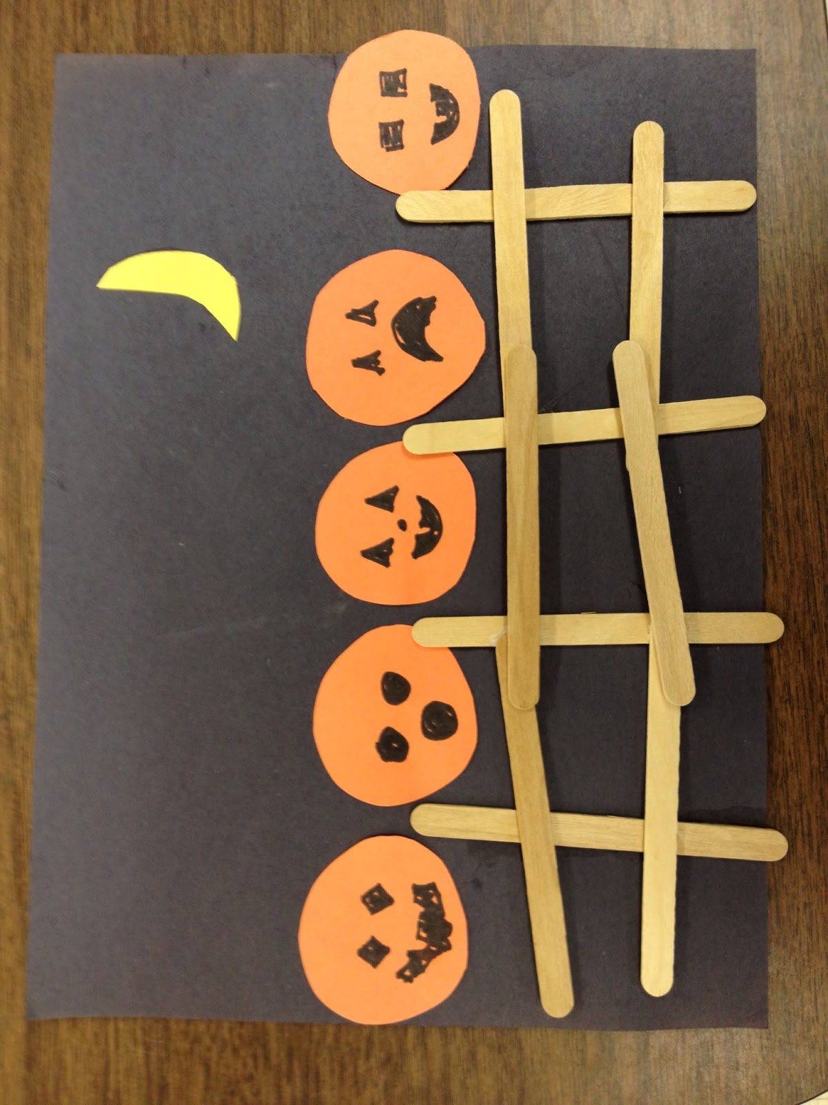 Five Little Pumpkins Sitting on a Fence.