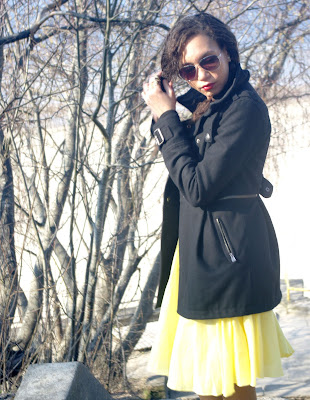 Black coat and a yellow warehouse skirt
