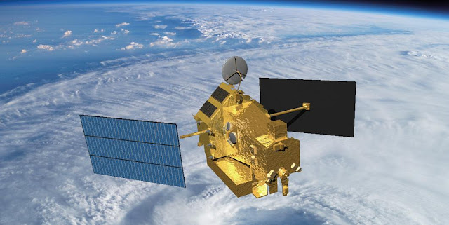 Visualization of the TRMM satellite in space over a tropical cyclone. Credit: NASA
