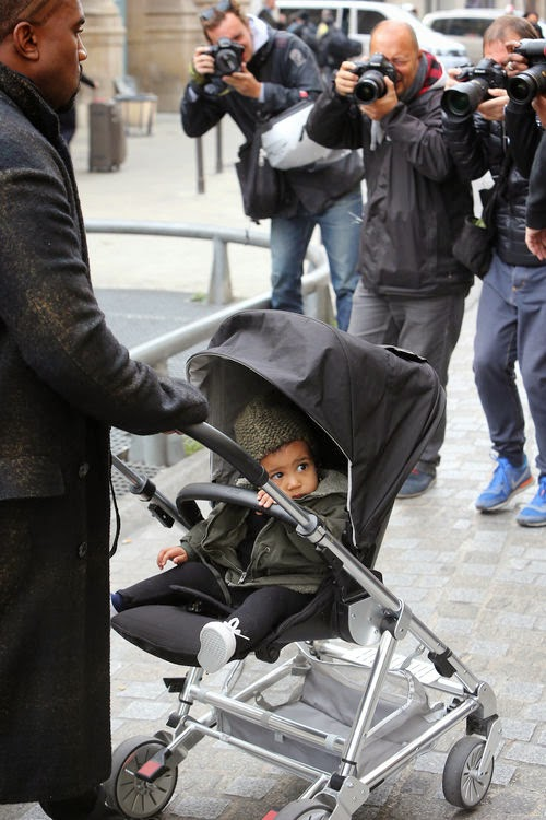Paparazzi siege North West as a photo object