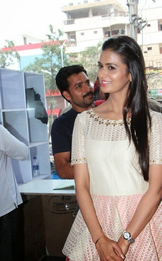 Meenakshi Dixit cute beautiful diva in Cream anarkali Dress at Pictures at Yes Mart Launch