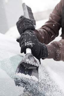 scraping ice off windshield
