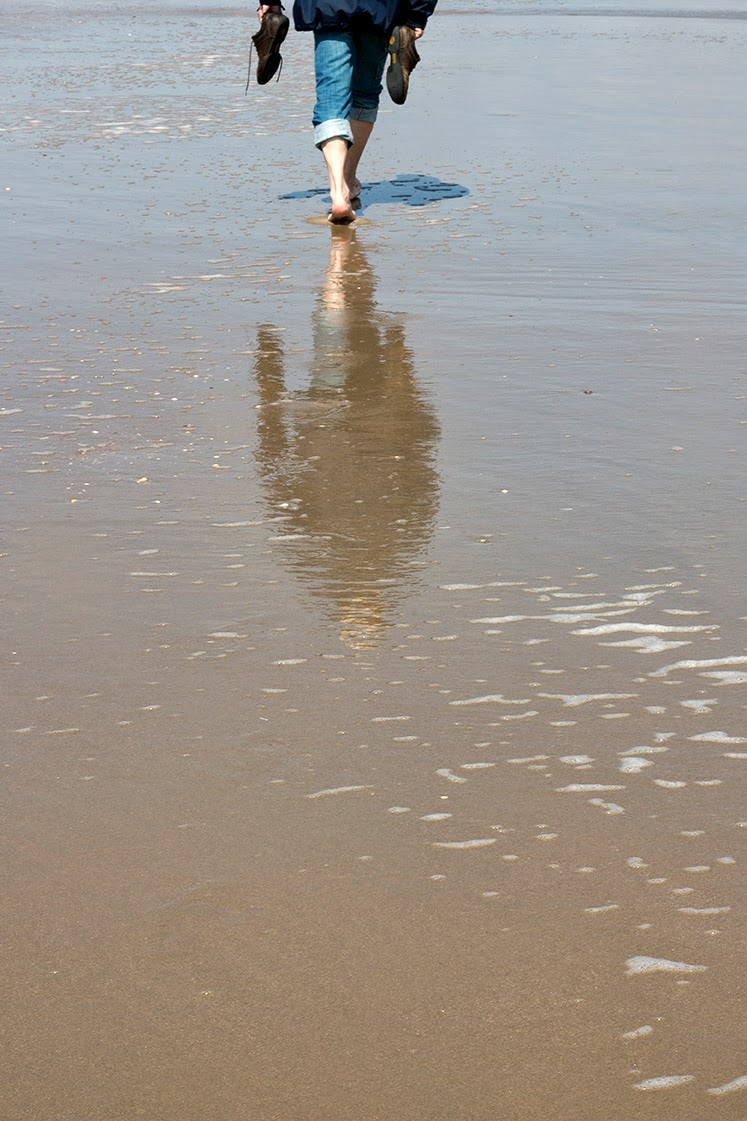 reflection of a man in the sea