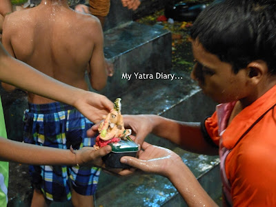 A clay Ganesha being carried for Ganesh Visarjan in an artificial lake in Mumbai