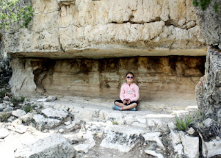 Tessa tested out a cliff recess at Walnut Canyon that was probably used by the Sinagua people for storage.