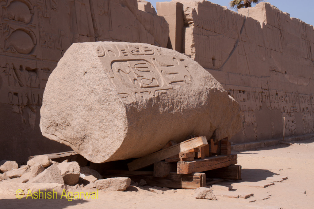 Large section of stone with carvings inside the Karnak temple in Luxor