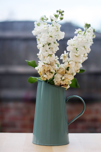 A photo of a jug holding flowers