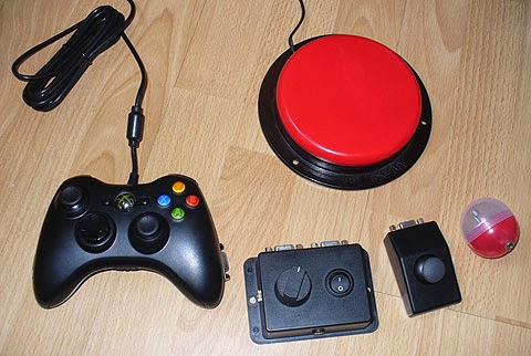 OneSwitch assistive technology, work in progress. An adapted Xbox 360 joypad, VRAA! box, External thumb-stick, Vibro capsule and Ablenet Switch