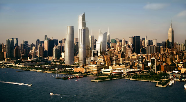 Picture of four new buildings in the phase one development of Hudson Yards as seen from the air above the Hudson river