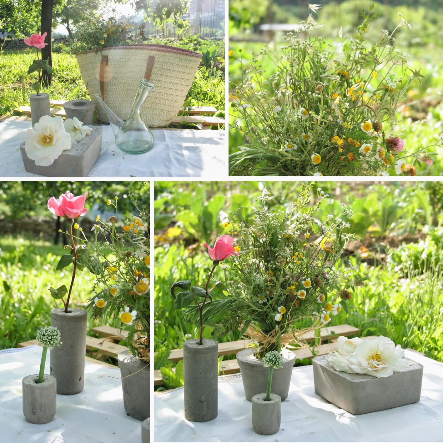 Mi niña decorando la mesa del picnic del huerto con un palet y los diy floreros de cemento2