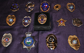 Badges from some of the agencies represented at LIFE.