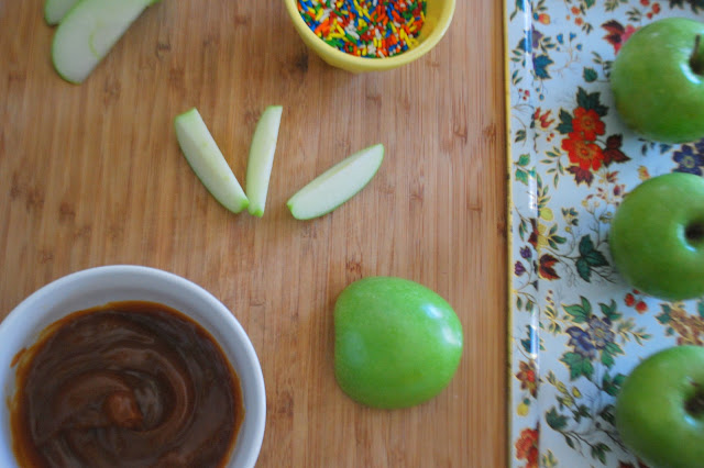green apples sliced, caramel sauce, rainbow sprinkles