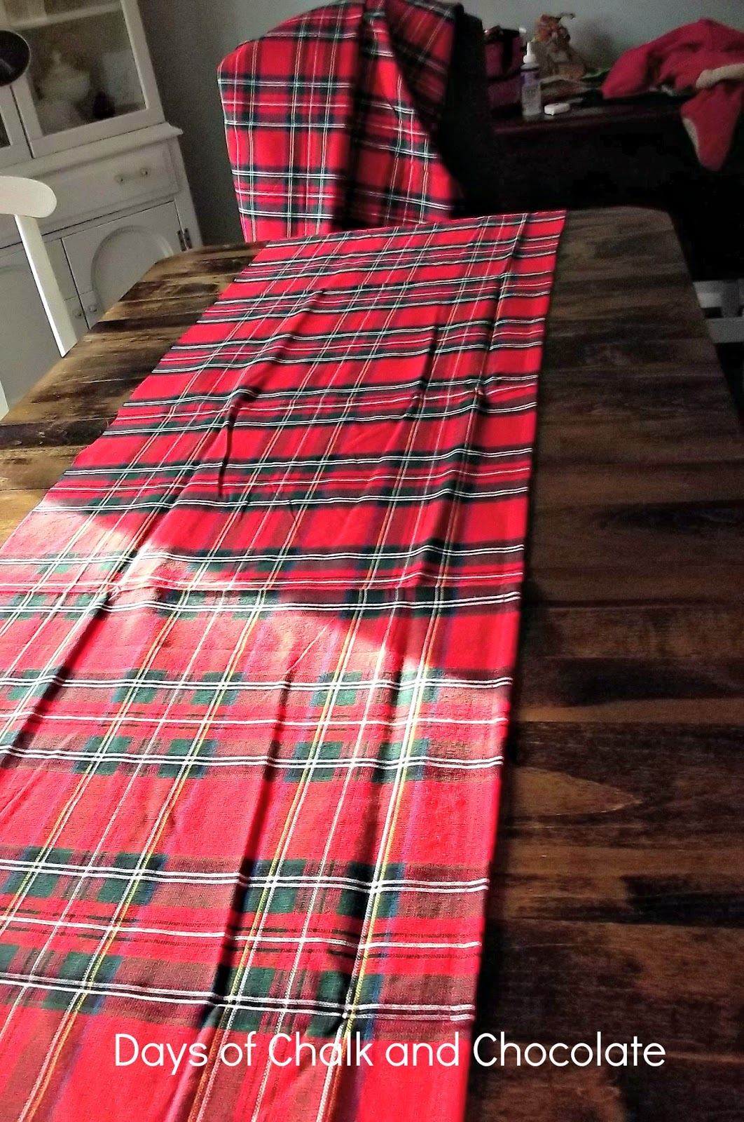 fold over 12 inch on the raw long side iron fold over again iron sew i only had one raw side because i kept the factory seam on the other - Christmas Plaid Table Runner