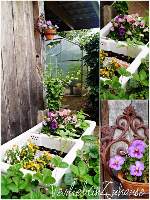 Waschbecken als Blumentopf und rostiger Topfhalter für Garten