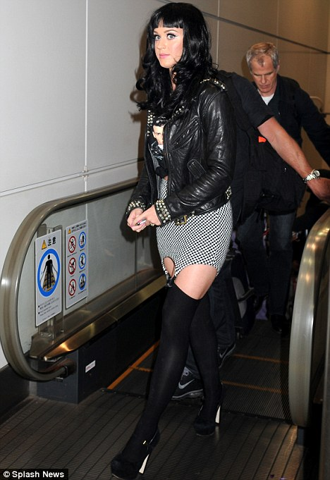 Look what you're missing Russell! Katy Perry sports sexy suspender skirt and stockings...