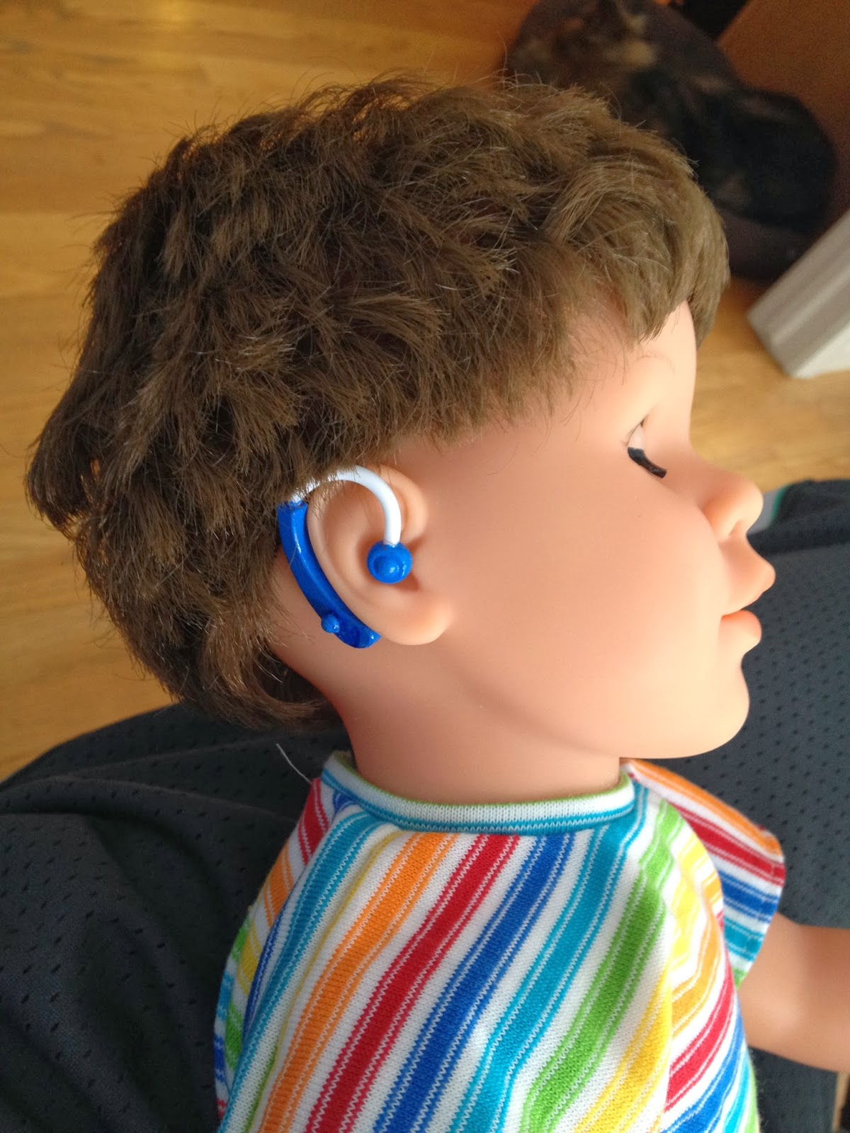 doll with hearing aids