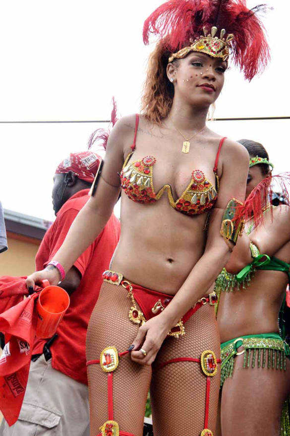 Rihanna in her homeland enjoying carnival. The singer wasn't shy to show off her beautifully toned body when she took part in a traditional Bajan festival.