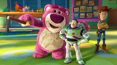 Lotso, Buzz, and Woody play games in Toy Story 3, written by Catching Fire scribe Michael Arndt.