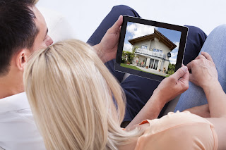 couple looking at house online